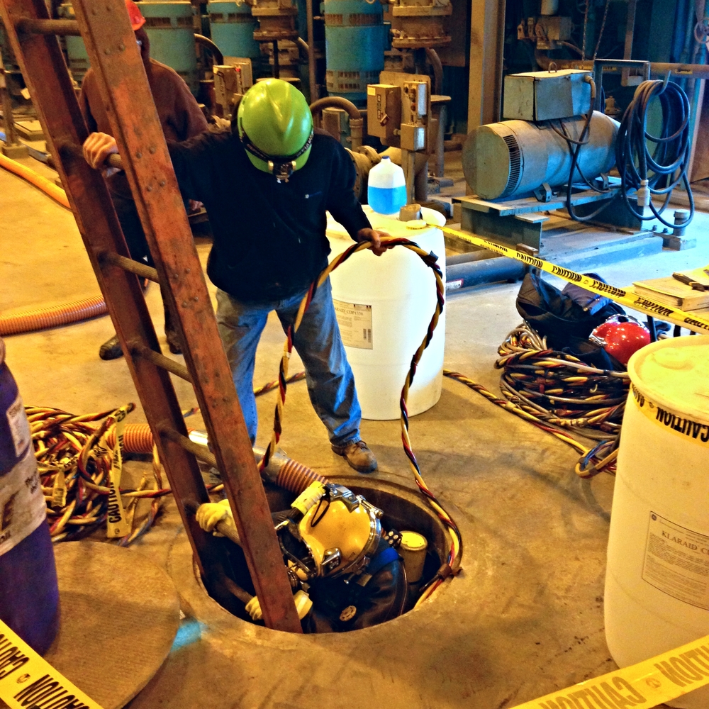 ES-Divers completing a Confined space/contaminated water dive at a steel plant. ES-Divers cleaned out debris from the interior of a holding tank.