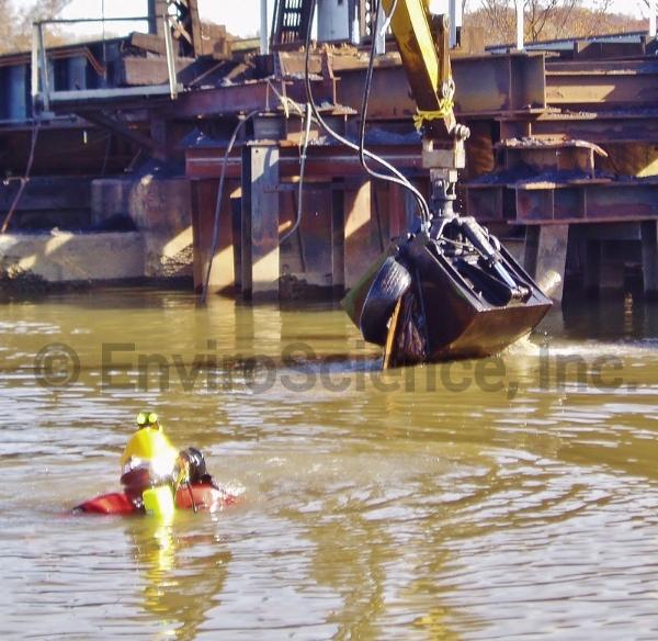 ES Diver assisting in underwater debris removal.
