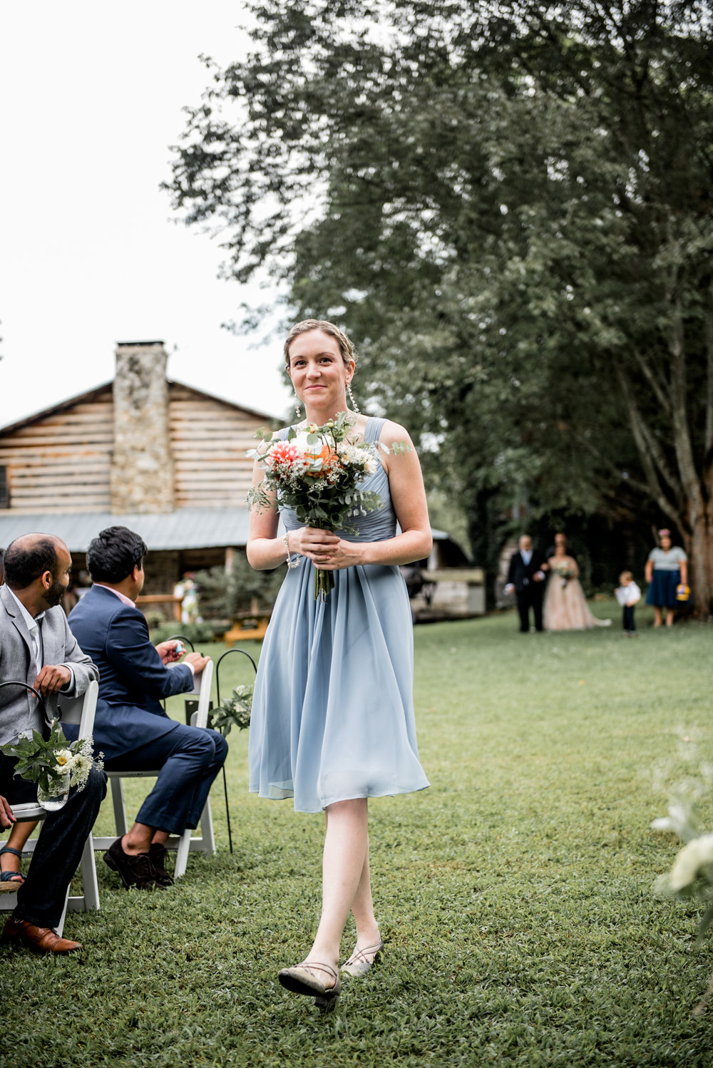 bridesmaid walks down aisle