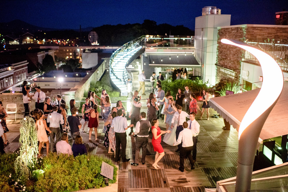 the party goes into the night on the downtown rooftop