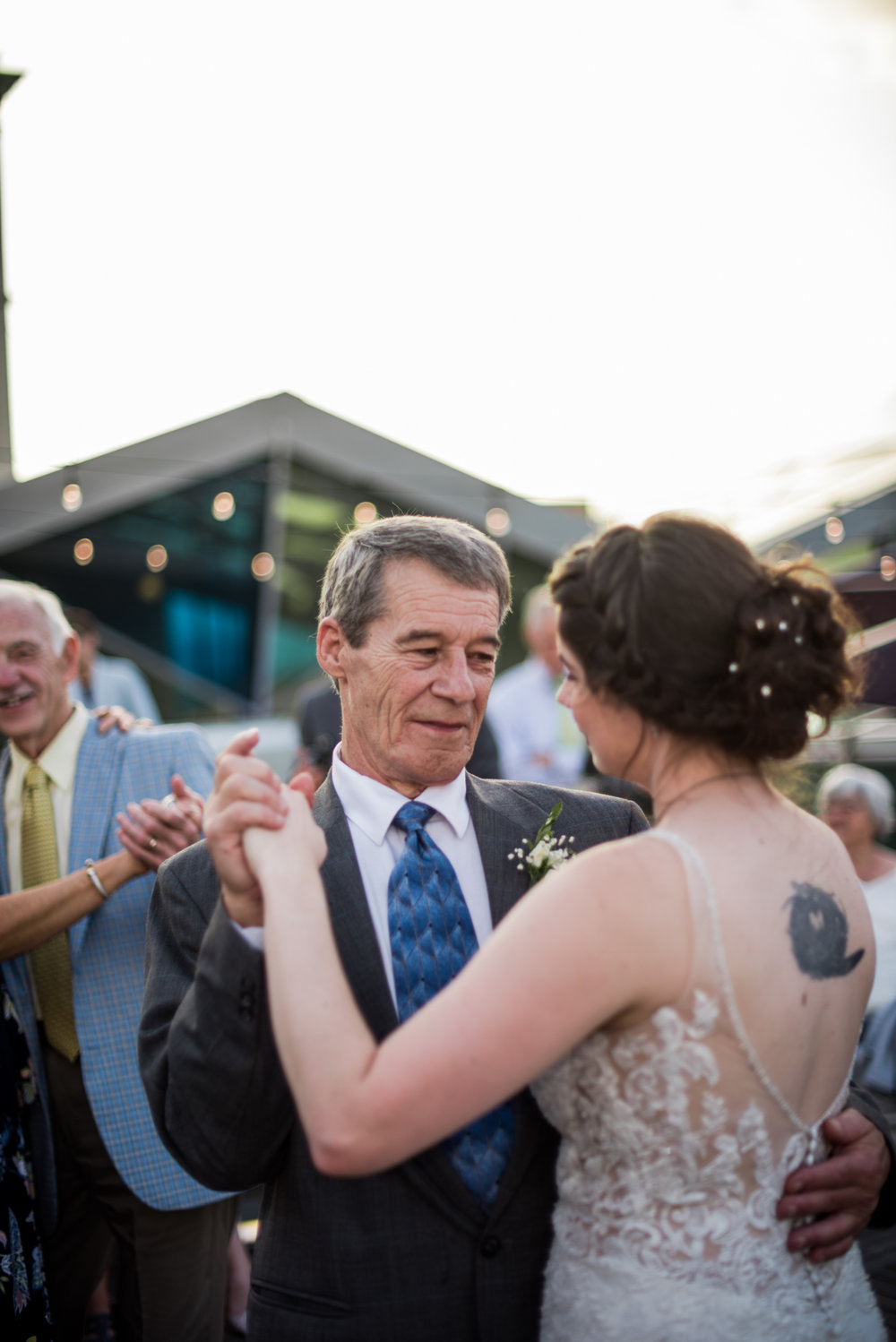 father daughter dance on downtown rooftop