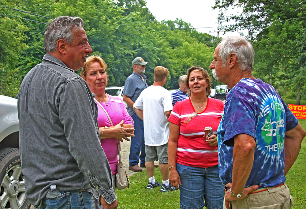 Local environmentalist, activist, and award-winning former teacher at Dundee-Crown, Gary Swick, speaks with the family at Angelina Place.