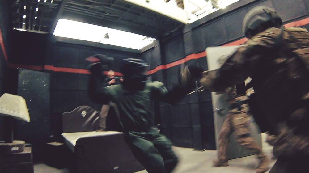 Combatives training in shoothouse