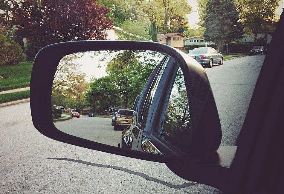 Use car mirrors for awareness and personal protection