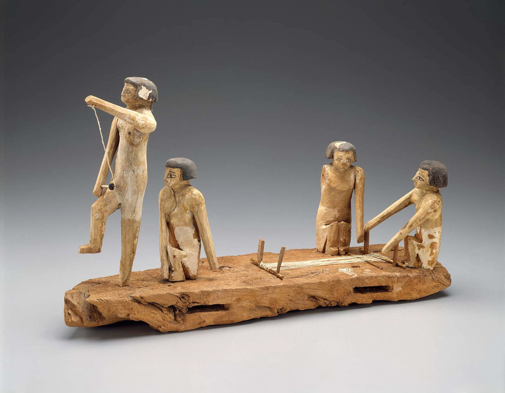 Egyptian, Middle Kingdom, late Dynasty 11 – early Dynasty, 2010–1961 B.C. Painted wooden model of a group of women spinning and weaving. The two women at the front are spinning flax. The two women at the back are working on a loom. Museum of Fine Arts, Boston.