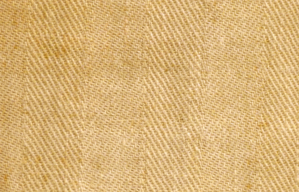 Close up of Shroud fabric, with its distinctive three-to-one herringbone twill weave.
