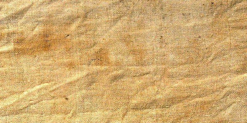 Close up detail of  Egyptian mummy linen fabric from Tutankhamun's embalming cache. Metropolitan Museum, NYC. This cloth is woven in plain weave.