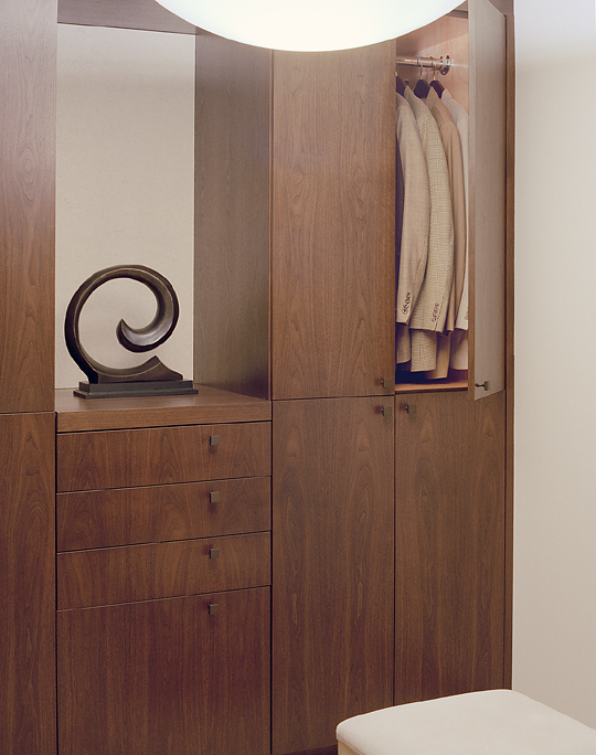 Walnut walk in master closet.