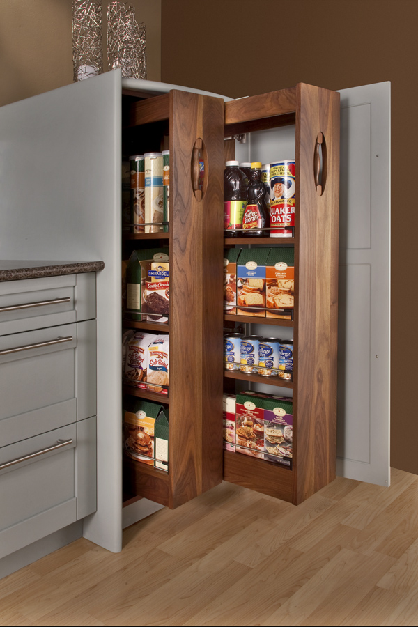 Two pull out pantries behind a single door.  Notice the furniture detail in the pull itself.