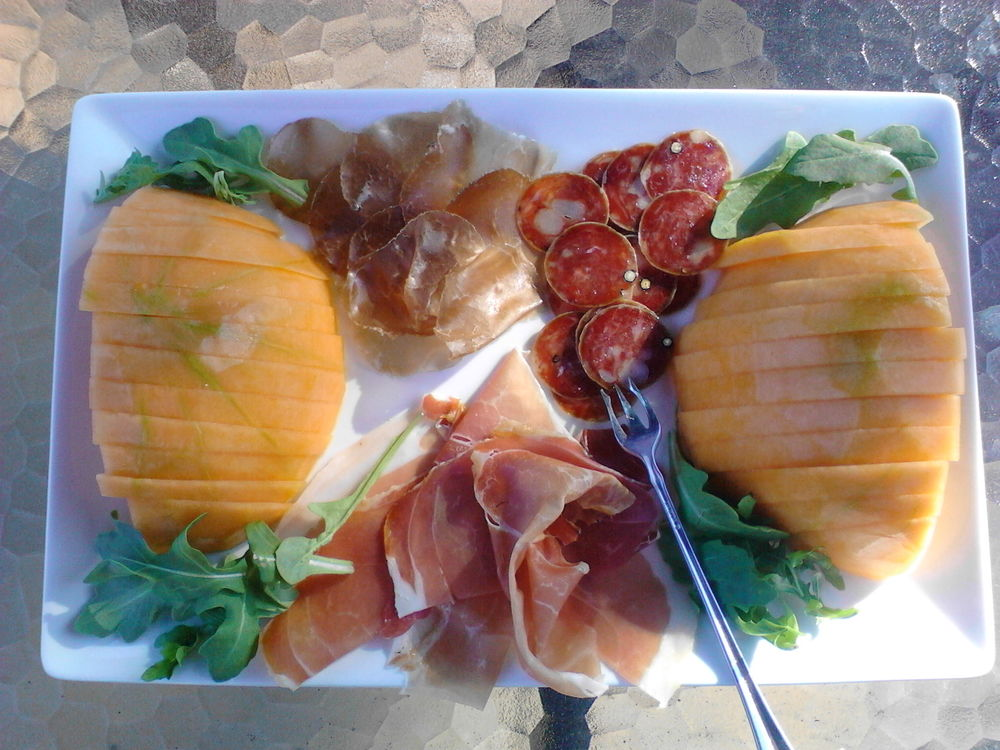 Prosciutto San Daniele, bresaola, duck and black peppercorn salami with cold cantaloupe and arugula. Really easy, most of this is just cutting things up.  I like to buy a small amount of more than one preserved meat, it just makes it more interesting.  Cheers.