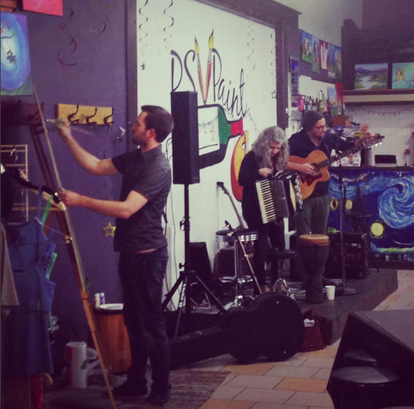 Josh paints while Eine Blume performs