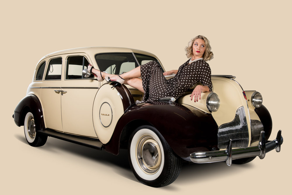 7commercial photography of cars with models in pin-up poses.jpg