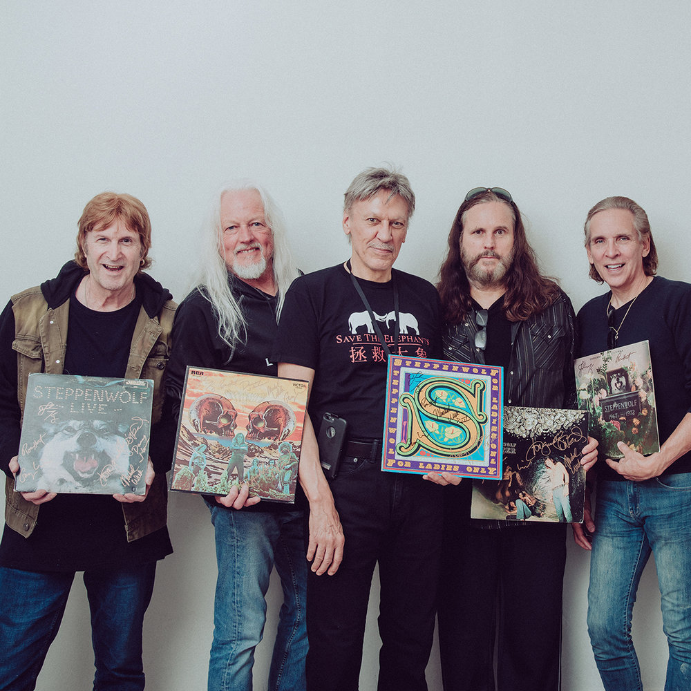 john kay and steppenwof final band photo posing with records.jpg
