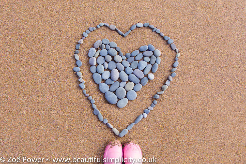 Fun with pebbles at Sandymouth beach