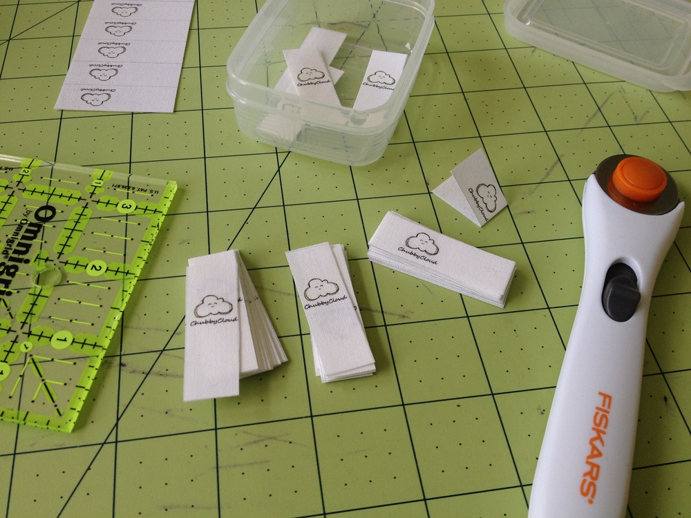 ChubbyCloud tags fresh off the printer and being cut