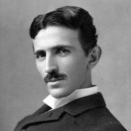 A photograph image of Nikola Tesla (1856-1943) at age 34