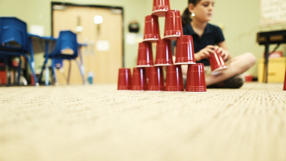 Girl stacking cups.jpg