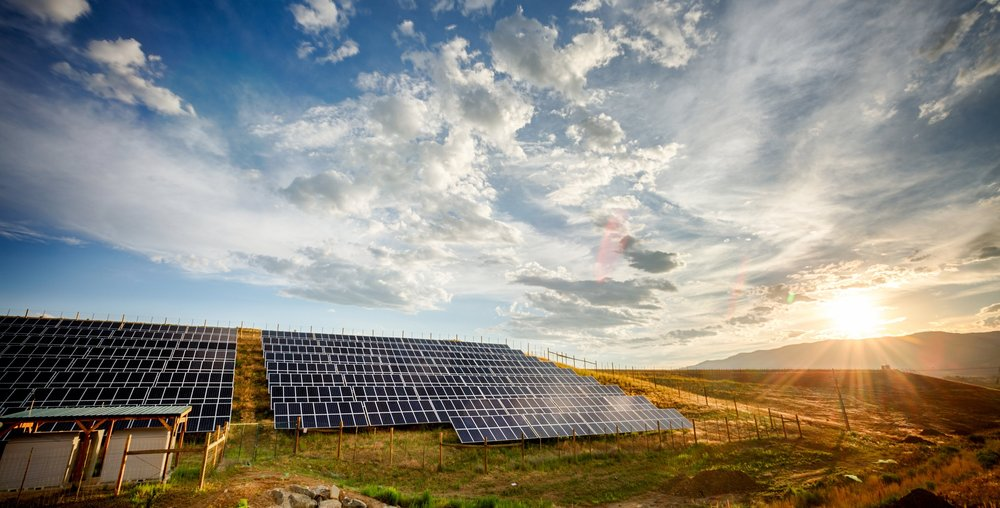 Solar-Panels-and-Green-Field-Under-Dramatic-Sky-at-Sunset-474147572_3871x2576.jpeg