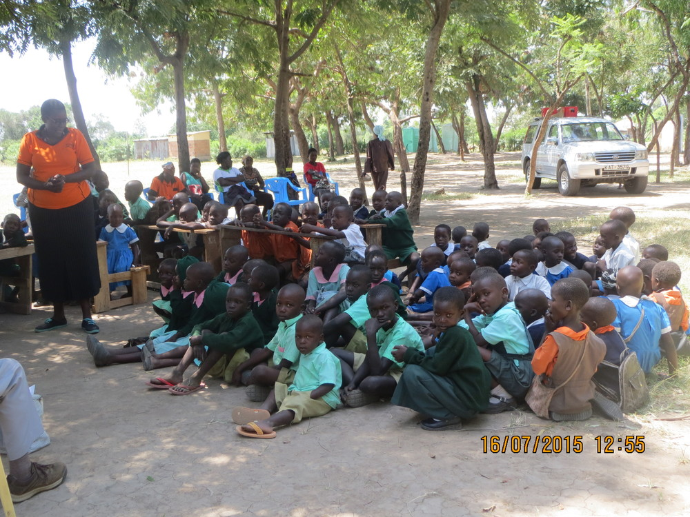 Kasirawa children enjoy the shade of the trees.