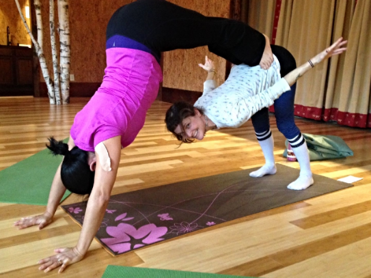 Jenny Shemwell and Holly Twining practicing double dog - a fun partner pose!