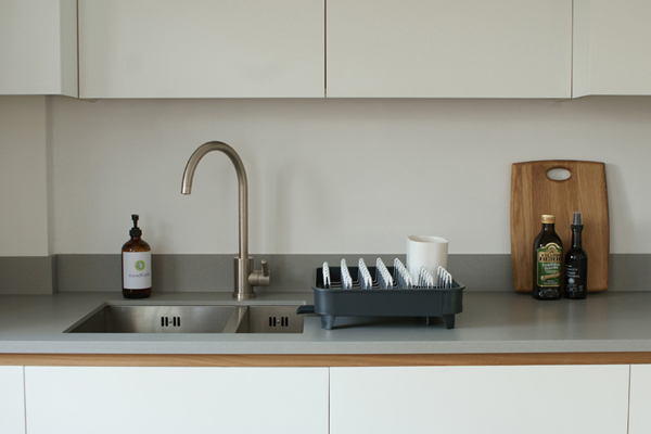 The sink area of a standforth bespoke kitchen, Corian work surface, stainless steel sink and tap