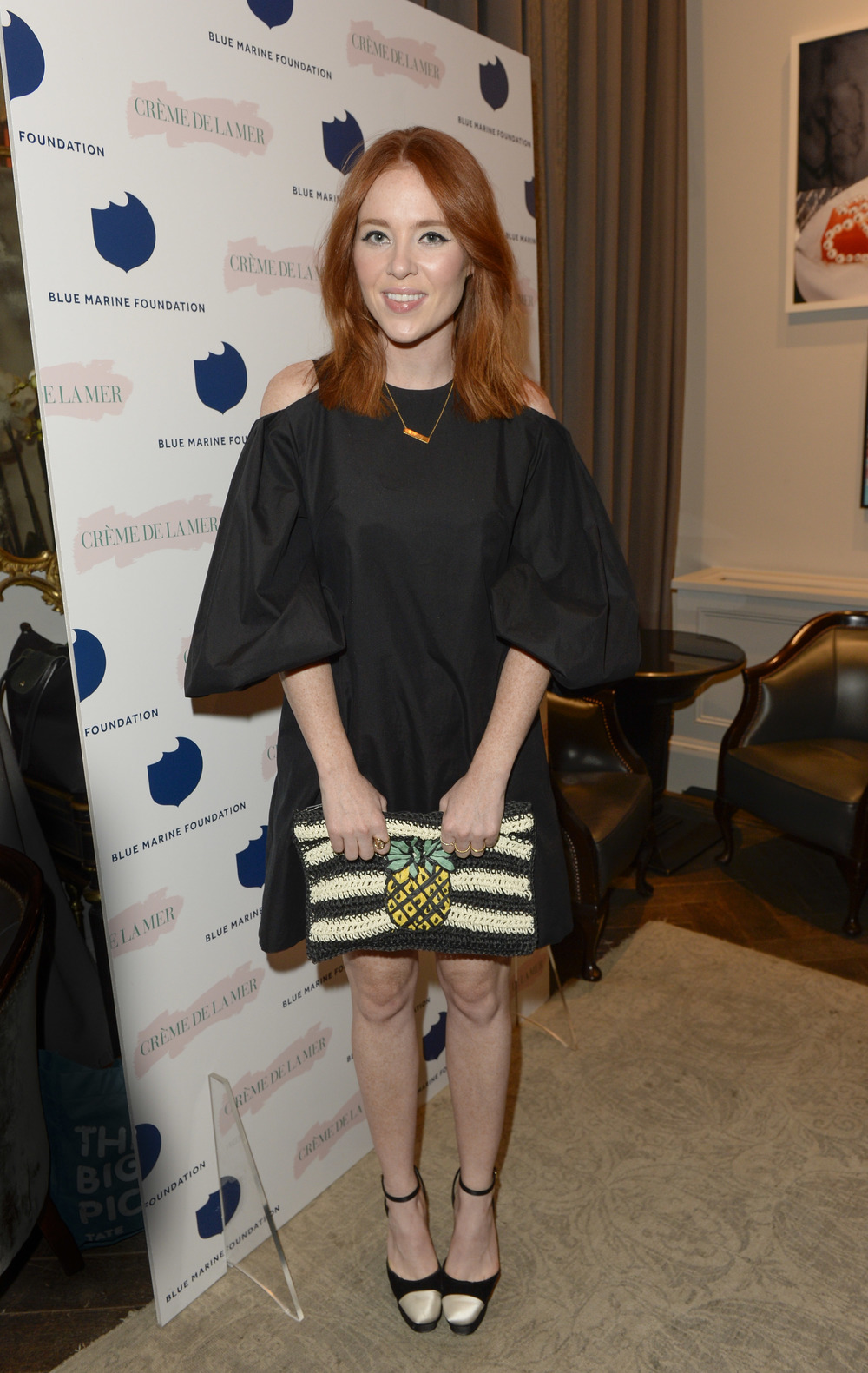 Angela Scanlon looked stunning in a LBD paired with a cute and quirky pineapple clutch from  Topshop
