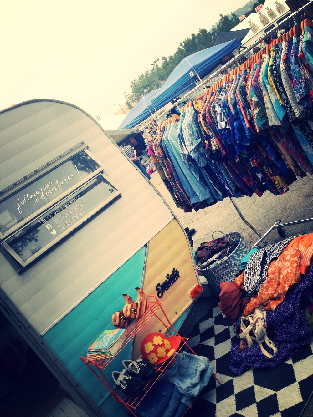 At the market for vintage clothing finds? Check out the adorable  Coast to Coast  vintage truck