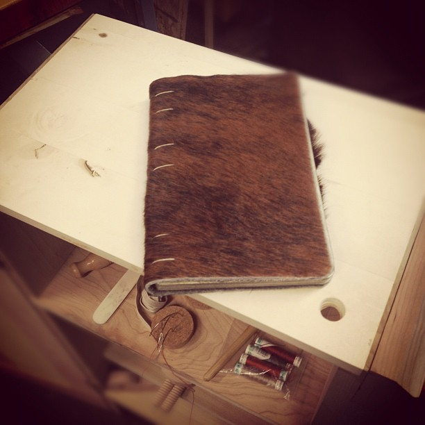 Finished this sketchbook repair for a friend, this cow hide looks like Pickle. (Taken with  instagram )