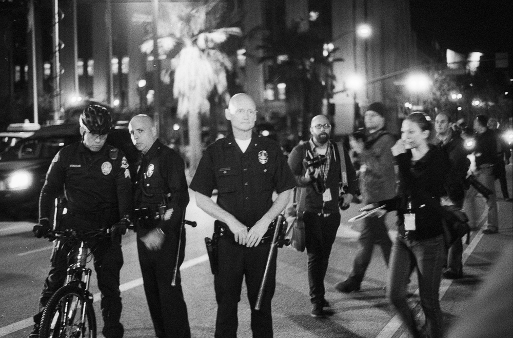 LAPD Commander Andy Smith in front of members of the LAPD during the Occupy LA. eviction in DTLA