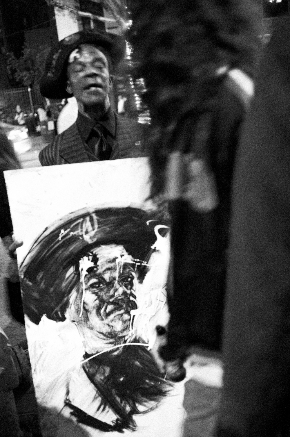 Ricky the Pirate walks around with a portrait of him by Robert Vargas during Artwork in 2011 in DTLA