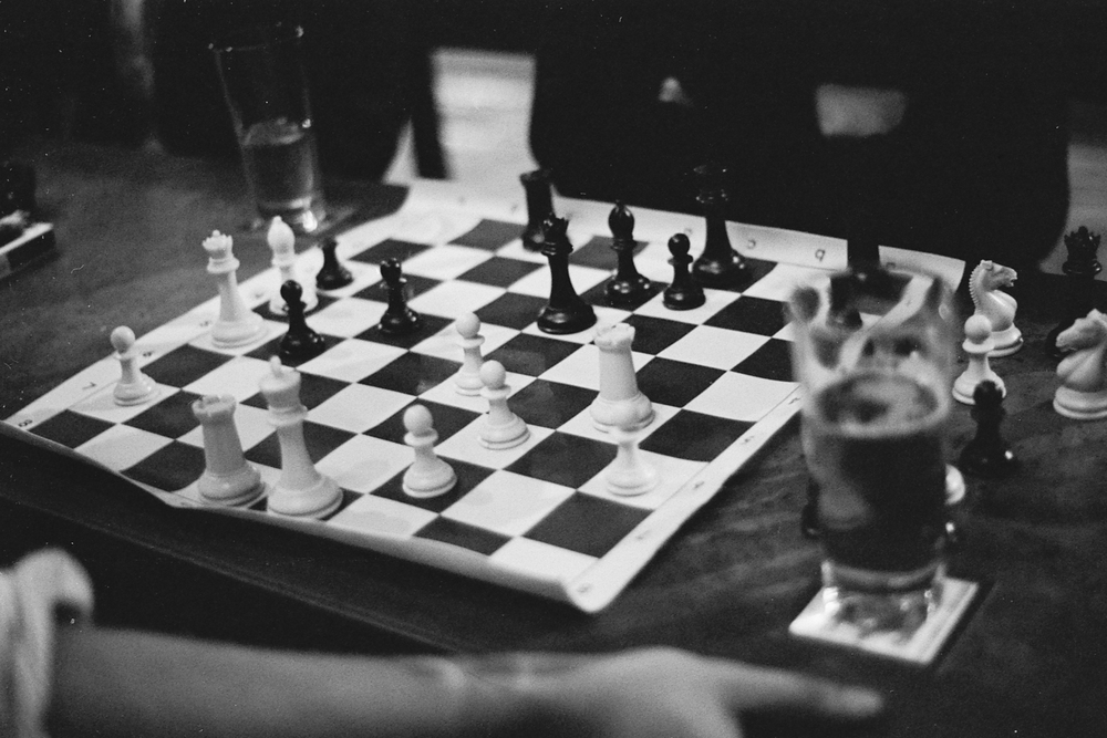 A game of chess is played at Spring Street Bar in DTLA