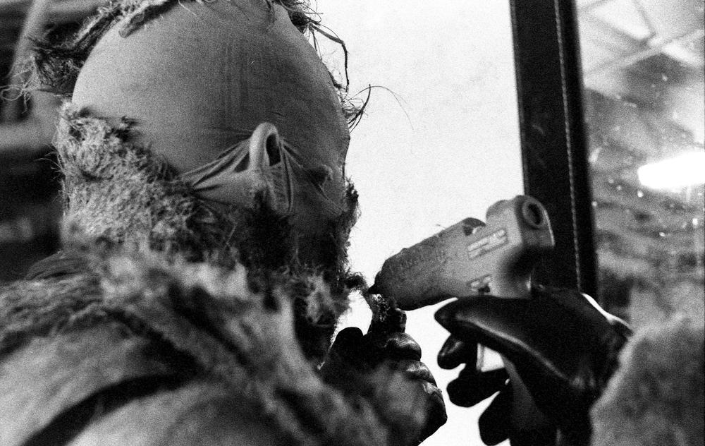 Tranimal Fade Dra applies a hot glue gun to her face before a performance at Mustache Mondays at La Cita in DTLA.jpg
