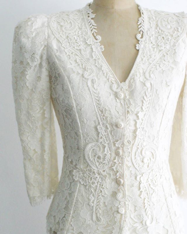 """Gorgeous #vintage #80s does #40s ivory lace jacket / blazer. Three quarter sleeves, fully lined, shoulder pads. Front button closure and decorative buttons on each sleeve. Such a beauty.  46 + shipping Marked size 5/6 Best fit: Small  Bust: 36"""" Waist: 27"""" Sleeve length: 18.5"""" Length: 24.5"""" Brand: Cachet by Bari Protas Excellent condition  Claim in the comments and then DM with email address and zip code!  #Etsy #forsale #shopmycloset #closetshop #instashop #instasale #ThriftFix #JupeDuJour #shopsmall #ootd #vintageclothing #vintagestyle #pinup #rockabilly #wedding #vintagewedding"""