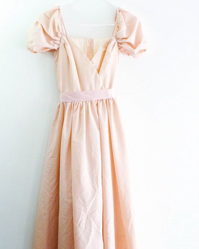 "Darling #1970s or early #80s #vintage very pale pink #prom style dress. Off the shoulder style, with thin straps and puff sleeves. Faux wrap bust, belt loops and coordinating ribbon belt. Fully lined and has a layer of tulle. So so sweet for #Valentines day!  62 + shipping Size: estimated xxs - xs Bust: 30"" Waist: 22"" Hips: free Length: 50' Material: polyester Brand: Roberta California Condition: great vintage condition; ribbon belt is fraying at ends  Claim in the comments, then DM with email address and zip code!  #Etsy #forsale #shopmycloset #closetshop #instashop #instasale #ThriftFix #JupeDuJour #shopsmall #ootd #vintageclothing #vintagestyle"