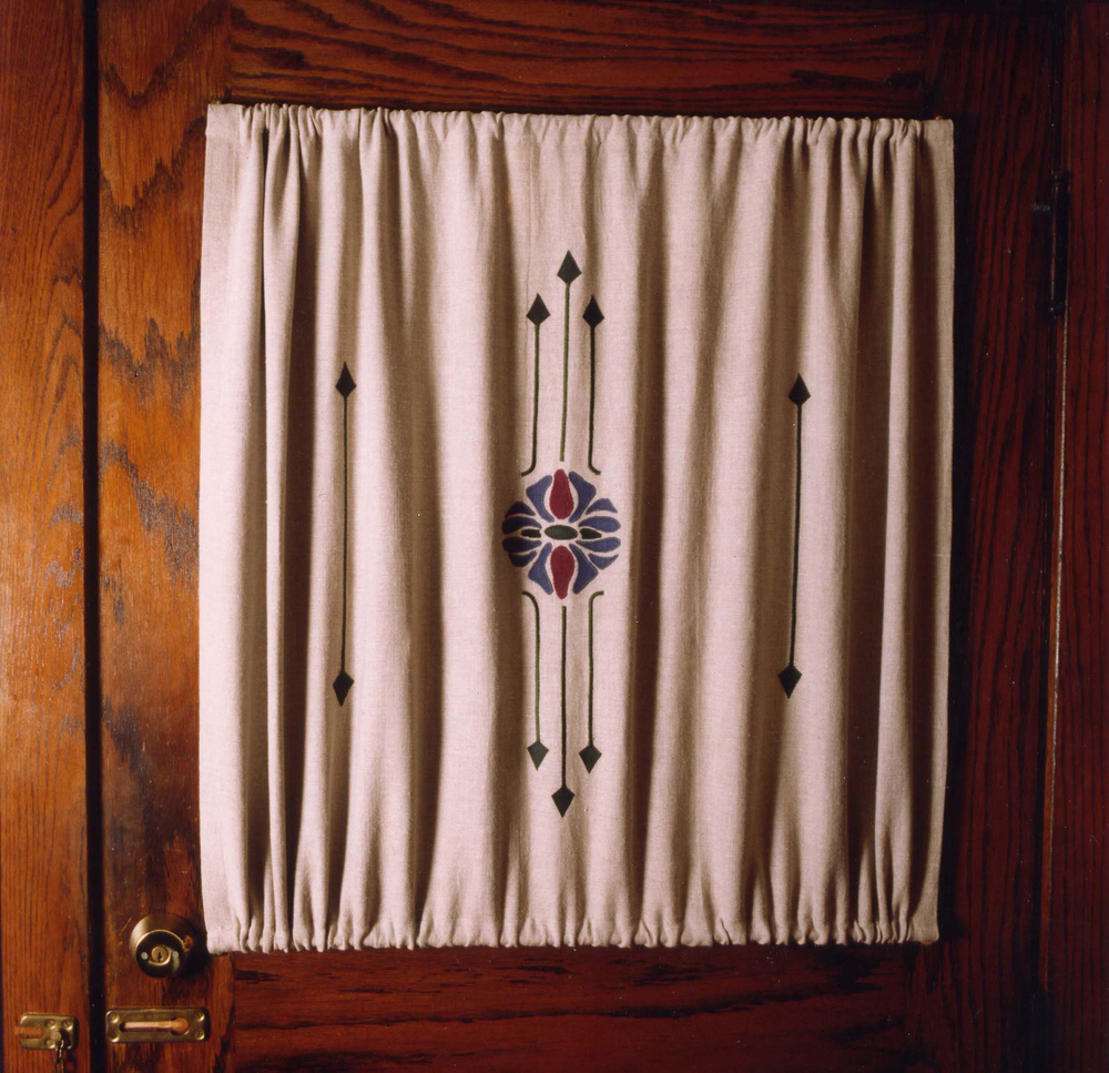 Curtains on door windows often have a rod pocket top & bottom to keep the curtains from getting caught in a hinge.