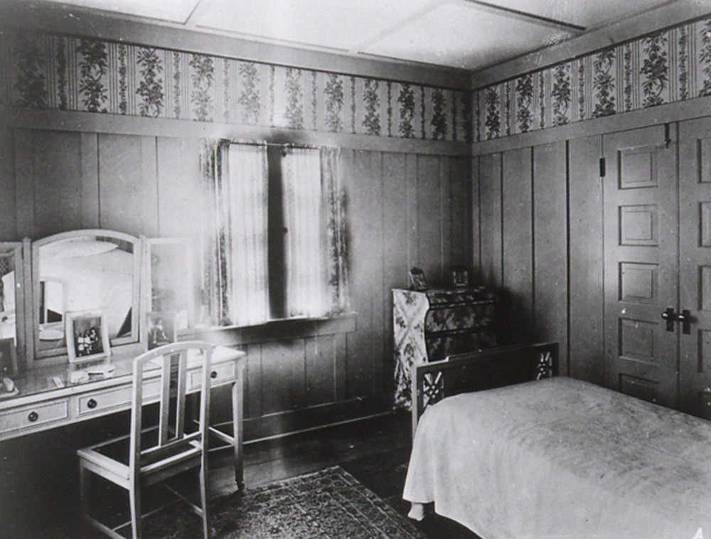 This vintage bedroom shows a typical period bedspread - a single layer of fabric, perhaps something as light as muslin or seersucker in the summer - intended to protect the proper bedding from dust.