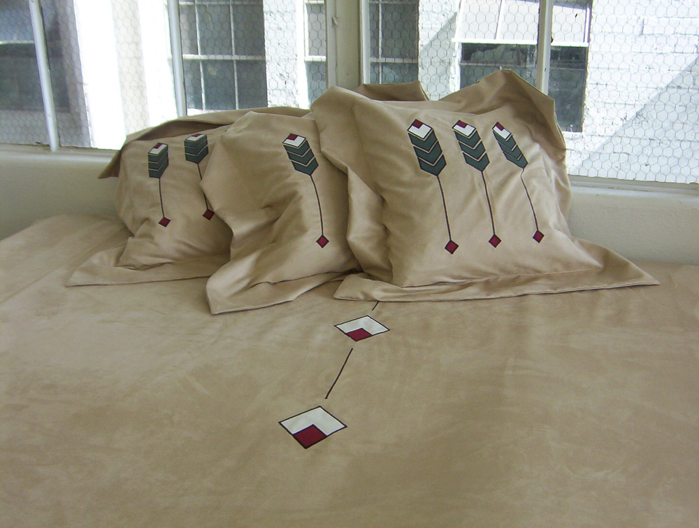 Flanged pillows and a spread with an adaptation of the Prairie Grass applique.