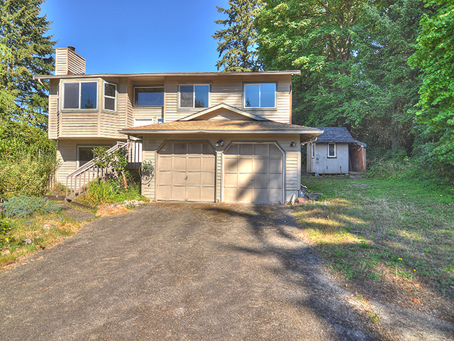 7711 NE 167th St, Kenmore, WA 98028 4 beds, 2 baths, 1584 SF, built in 1984. Split level home, finished basement.  Secluded lot, private drive, MIL unit with 2nd kitchen, carport, wired for generator, large garden space,  12320 SF lot.