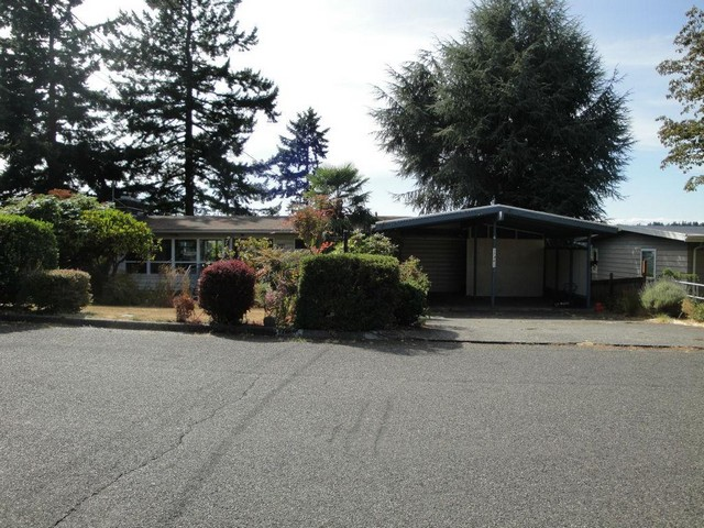 HUD home!  Terrific Puget Sound views, 5 bedrooms, 3 baths, wood wrapped vaulted ceilings, 2 fireplaces, 2250 SF, 2nd kitchen in the basement for possible mother-in-law, 8800 SF lot, 2 car carport.  FHA Case #561-940648. Buyer to verify all info.