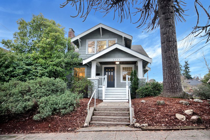 4233 Corliss Ave N, Seattle, WA 98103  Open Friday Jan 5th from 4-7pm, Saturday Jan 6th from 1-4pm and Sunday Jan 7th from 1-4pm.  A commanding Wallingford two story craftsman style home tastefully updated for modern living. Inside you'll find four bedrooms above grade, a large living room with fireplace, 2 full baths & an unfinished basement full of potential! Gorgeous refinished oak floors, classic built-ins, new carpet, master bedroom with vaulted ceilings, formal dining room, large kitchen w/ eating nook, & bonus den or play area. Corner lot with peek-a-boo city views, huge private deck, great parking, awesome Schools.  4 beds, 2 baths, 1640 SF above grade, 2 story with 910 SF unfinished basement.