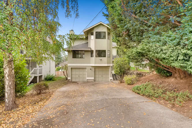 Settled quietly off a one way access street, this big 2 story plus basement home has a modern living layout. Soak in the SW territorial views just North of Green Lake from the awesome deck off the living room. The kitchen flows nicely to the dining area, family room with fireplace and main living. 2 car garage, new carpet, new appliances, updated kitchen, new water heater, new exterior paint! Large 2nd floor master suite. The lower bonus room doubles as a 4th bedroom, den, media or play room! 3 bedrooms on the 2nd floor plus 2.25 baths.    3 beds plus a bonus room/den/media room/4th bedroom  One full bath (Tub), One Three Quarter Bath (shower) One half bath  1780 SF on a 4153 SF Lot  Built in 1983  Taxes in 2018: 6364  2 car garage