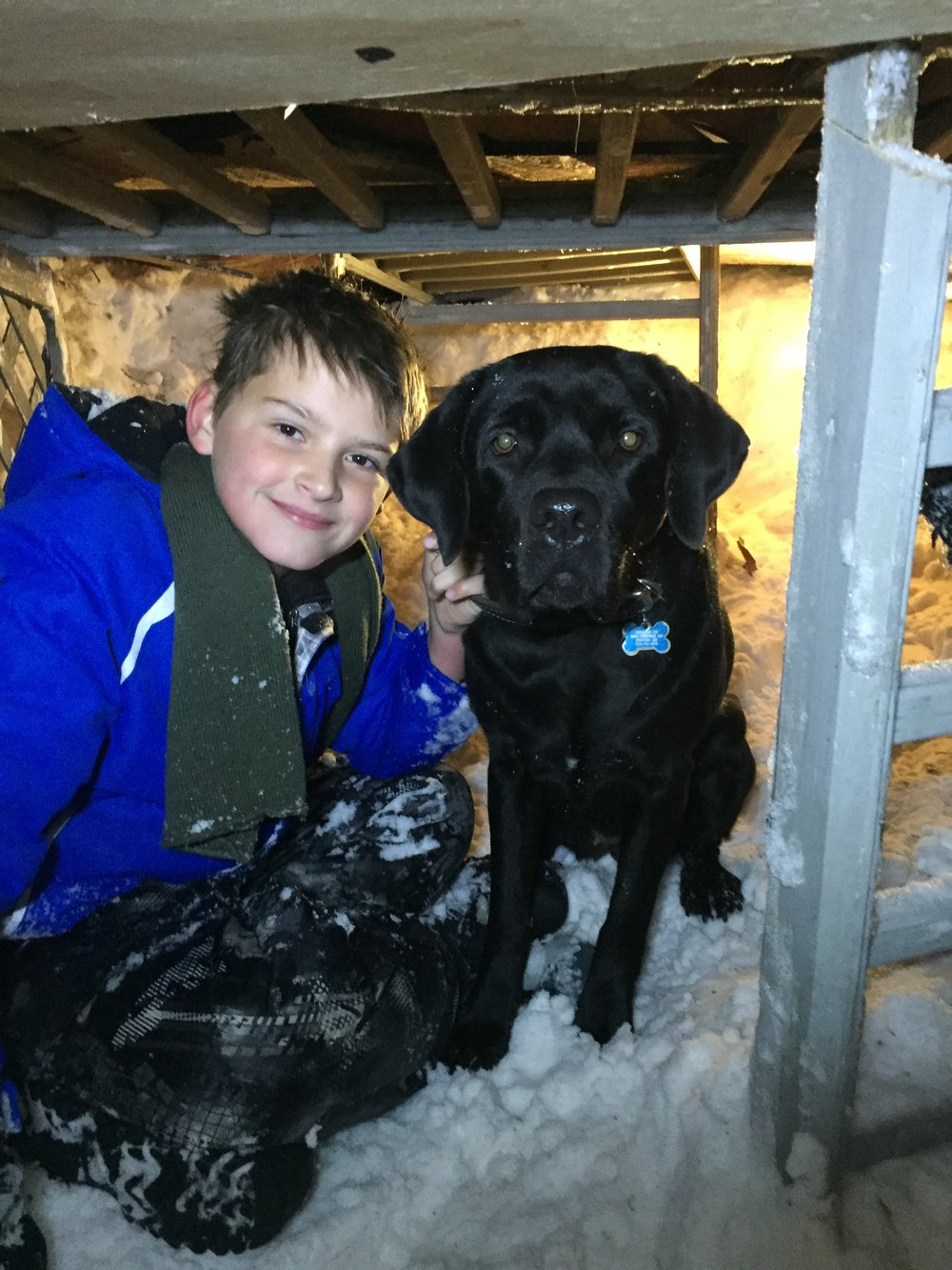 "A boy and his dog in their snow fort  ""Jack has a Matthew Perry vibe about himself."" - Stella Alex, Talent Agent, Savage Agency"