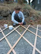 Construction crew assembles accordion frame