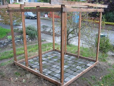 Just the frame, with a salvaged paver floor instead of just dirt