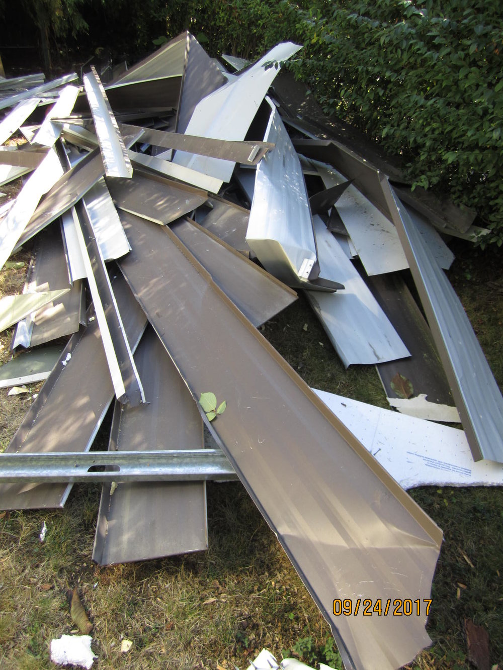 demolished steel roofing used for siding