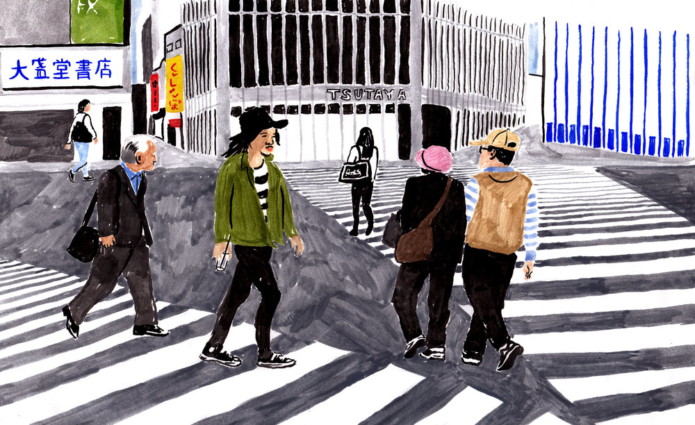 People navigating Shibuya Crossing.