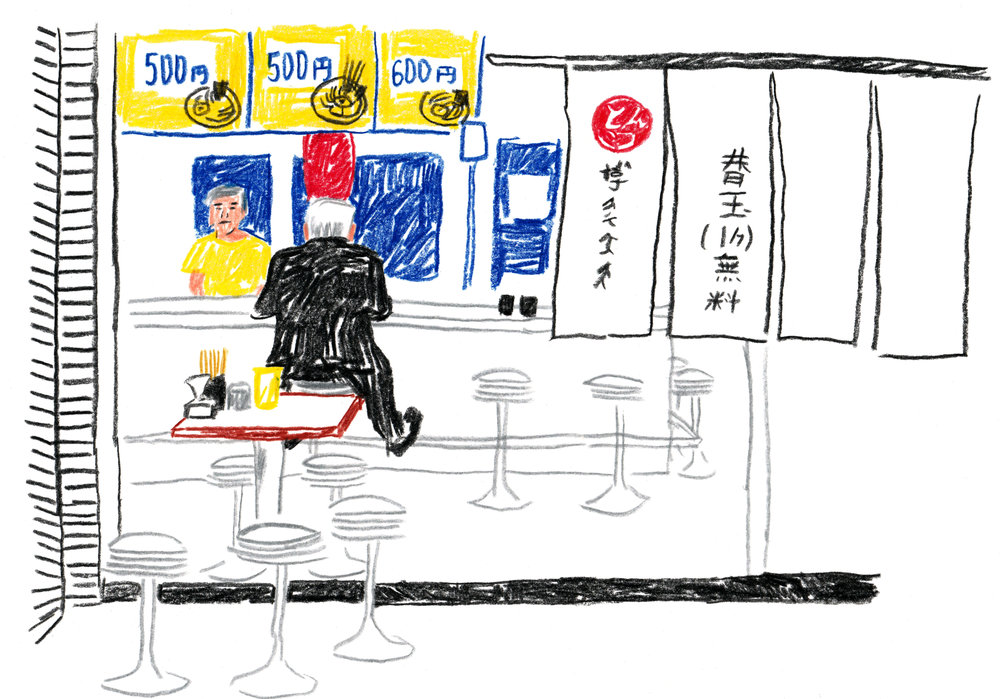 Man dining in at a ramen place in Tokyo.