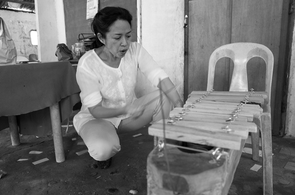 President Jalandoni praising a xylophone crafted by out-of-school youth