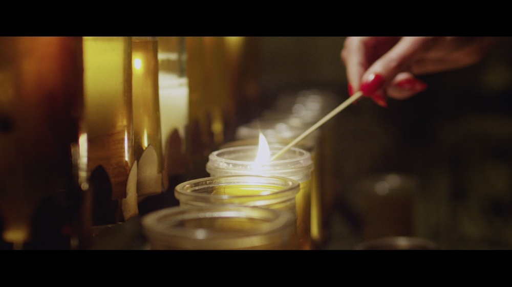 esther lighting candle.jpg