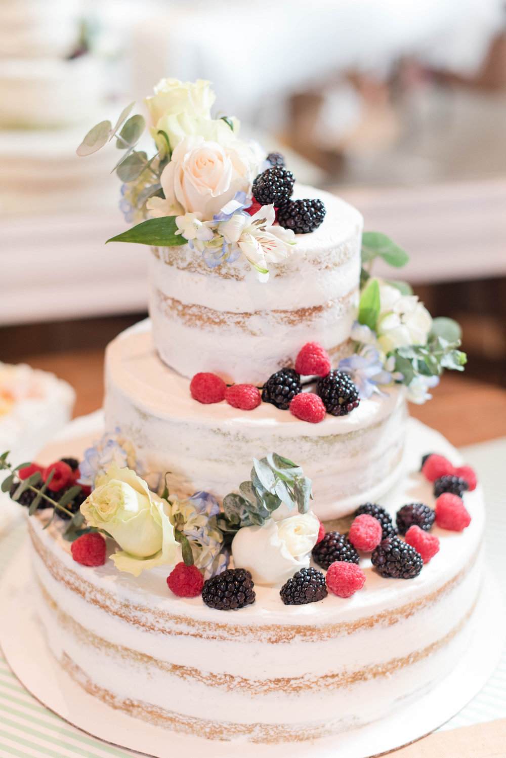 wedding cake berries tiered cake florals